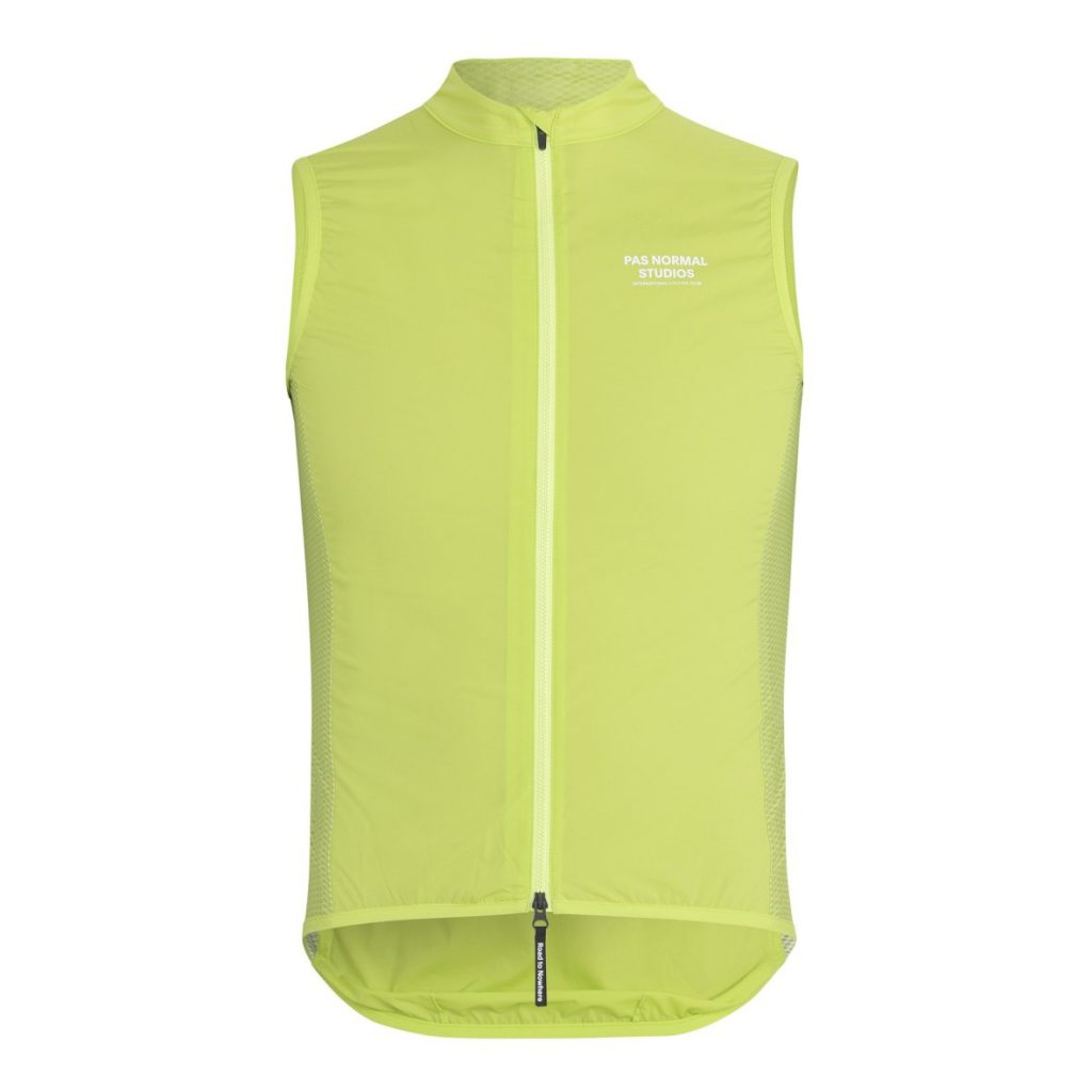 bright lime colored stow away cycling gilet. pas normal studios logo in white print on left chest. 1180w